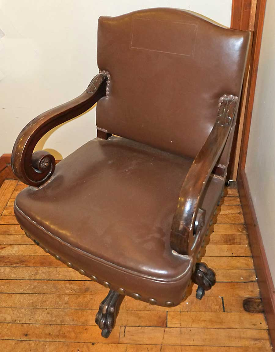DD Swivel Chair at Clearwater County Historical Society  for the 1905 Minnesota State Capitol, carved wood, covered with leather