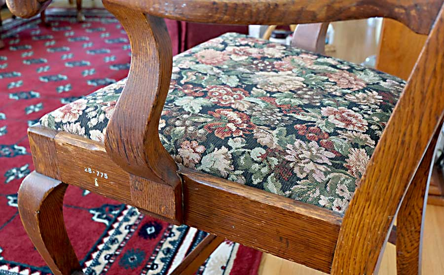 photo detail of 1087 Armchair, purchased by Cass Gilbert for the 1905 Minnesota State Capitol, carved wood with fabric cushion seat cover, pair located in South St, Paul, Minnesota