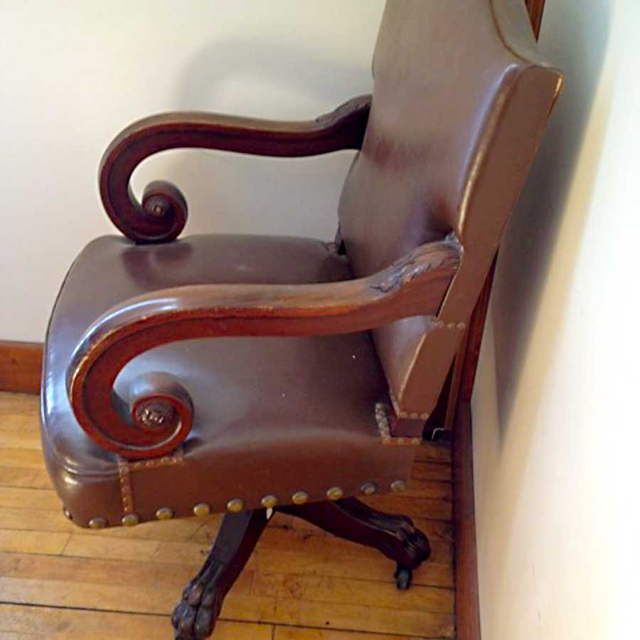 photo of DD Swivel Chair at Clearwater County Historical Society  for the 1905 Minnesota State Capitol, carved wood, covered with leather