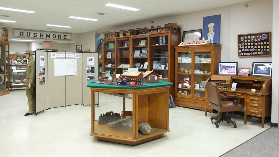 panorama photo of Nobles County Historical Society collections display, featuring DD Swivel Chair