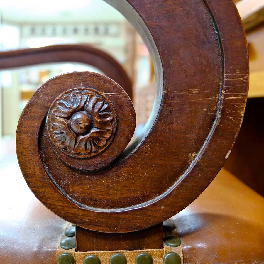 Close photo of arm of DD Swivel Chair designed by Cass Gilbert for the 1905 Minnesota State Capitol, now in Nobles County Historical Society
