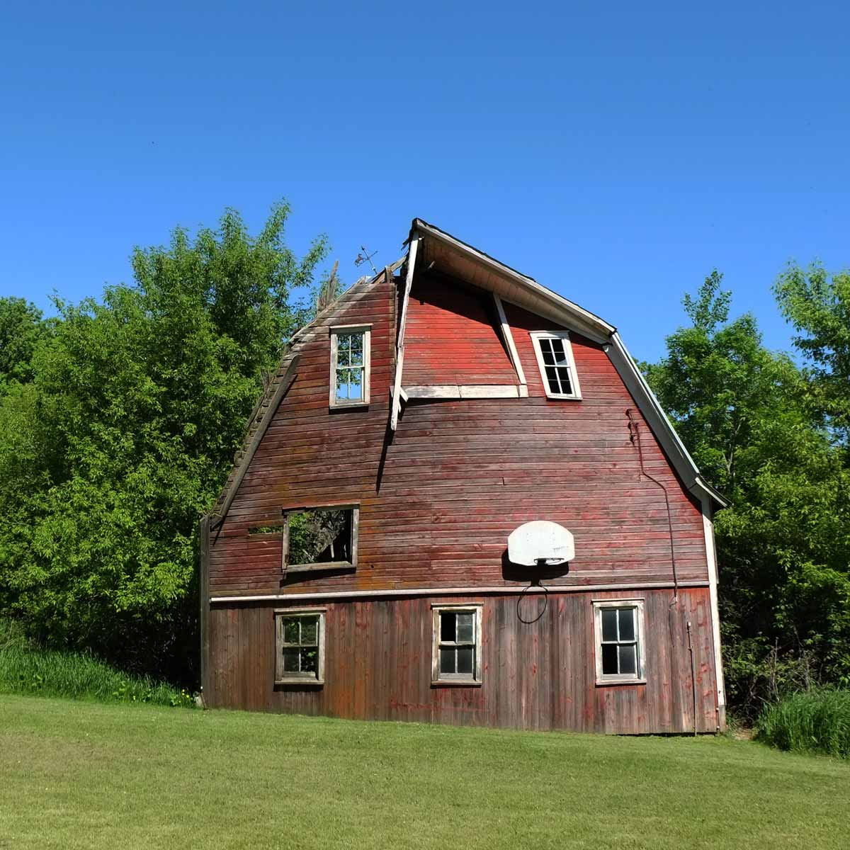 color photo barn in Stanchfield, Minnesota, where several original windows have been stashed since 1974